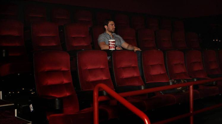 movie theater alone