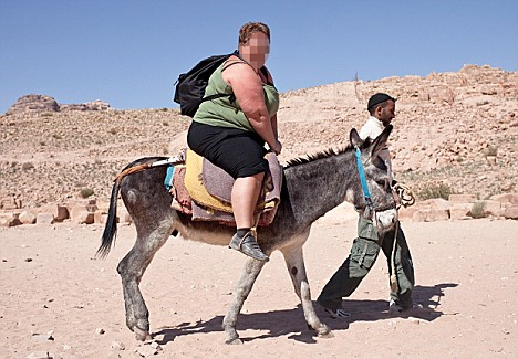 Overwight tourist on donkey - non PIXELATED.JPG